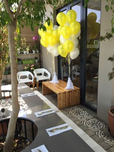 Yellow and White balloons at a restaurant in Bryanston