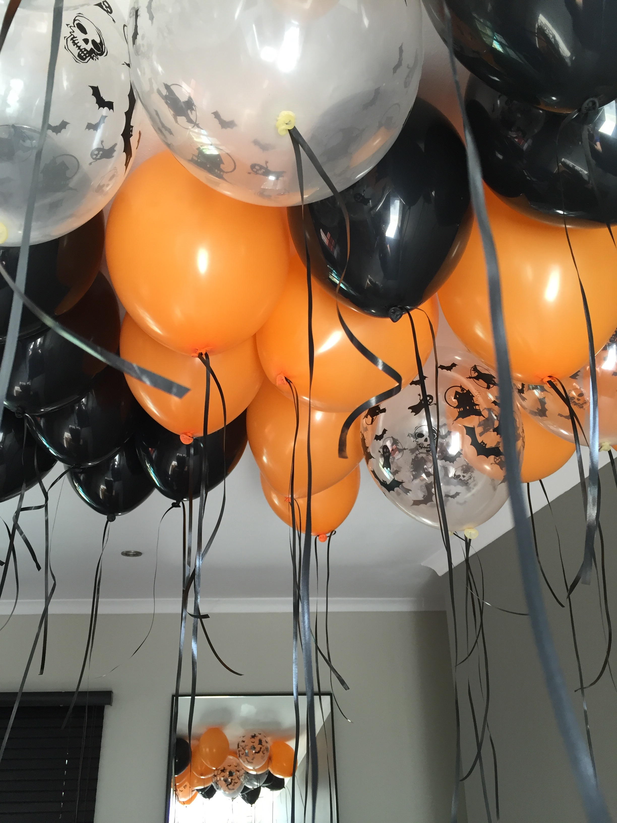 Orange, black and halloween printed crystal clear balloons